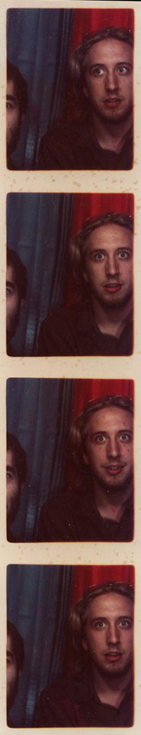 Kip and Patrick in a photobooth.